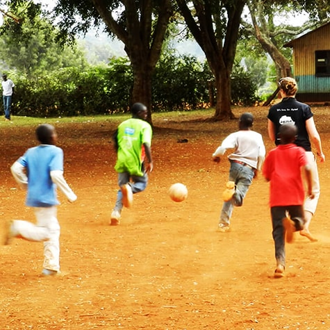 Kids in Playing Football With Volunteer in Kenya