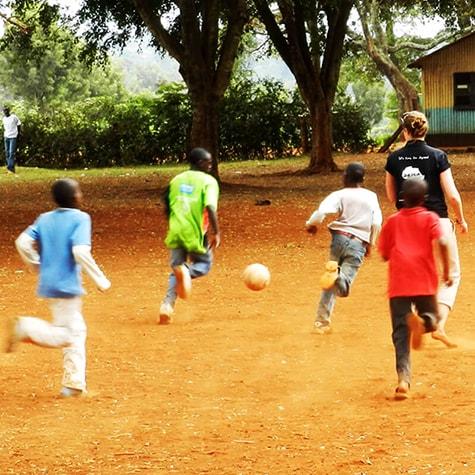 Kids in Playing Football With Volunteer in Kenya