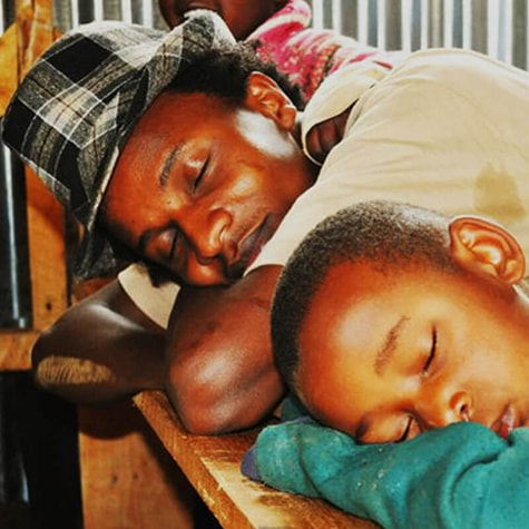 Izzo and Child Sleeping in African Classroom