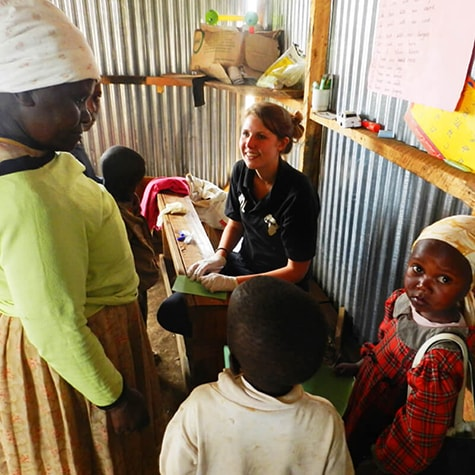 Volunteer Helping Family in Kenya