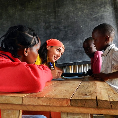 Volunteer Sat Down Teaching in Kenya