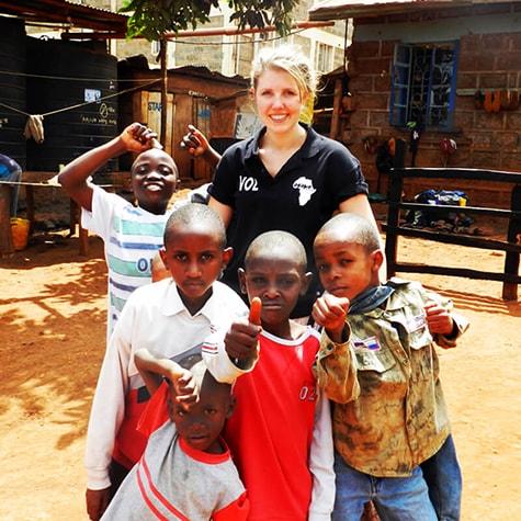 Volunteer With Small Group of Children in Kenya