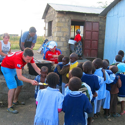 Volunteers Serving Food to Children in Kenya