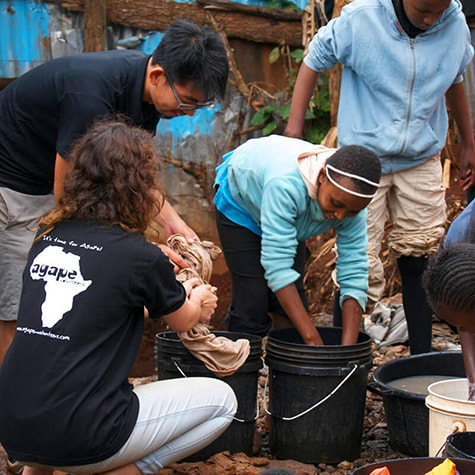 Volunteers Helping to Wash Clothes in Kenya