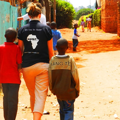 Volunteer Walks With Children in Kenya
