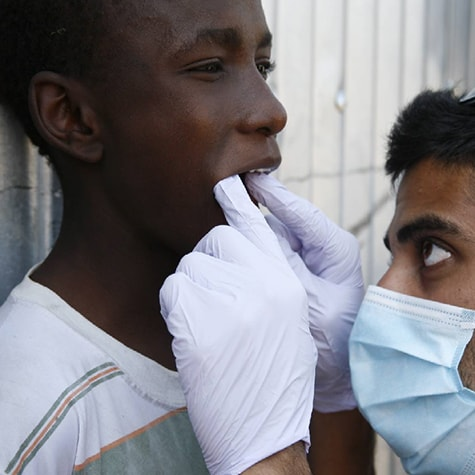 Medical volunteer Ghana checks child